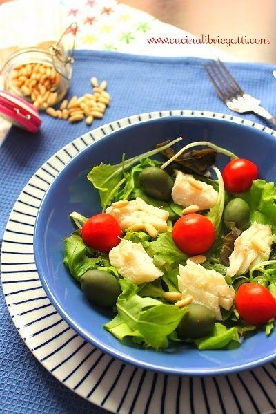 insalata di merluzzo con olive pinoli pomodori